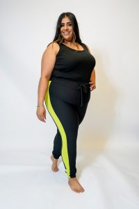 PLUS SIZE BLACK JOGGING BOTTOMS WITH LIME SIDE PANEL FRONT. 1