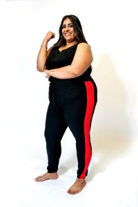 PLUS SIZE BLACK JOGGING BOTTOMS WITH RED SIDE PANEL FRONT.
